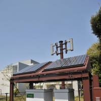 Off the grid: A 'green' DoCoMo base station, designed to operate on solar energy and lithium-ion batteries, stands outside the R&D center. | KAZUAKI NAGATA