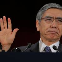 A believer: Bank of Japan Gov. Haruhiko Kuroda says Friday the BOJ's agressive monetary easing steps are working to achieve an exit from more than a decade of deflation. | AP