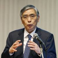 Business as usual: Bank of Japan Gov. Haruhiko Kuroda gives a lecture at Hitotsubashi University in the western suburb of Kunitachi, Tokyo. | KYODO