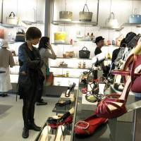 Shoe-in: Customers look at shoes at Singapore-based Charles & Keith's store in Tokyo's Harajuku district in April. | KAZUAKI NAGATA