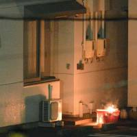 Nagakubo picks up food Thursday evening, and torches a basket a couple of hours later. | KYODO