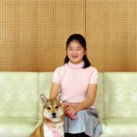 Big girl: Princess Aiko, who turned 11 Saturday, poses with her pet dog at Togu Palace, the residence of Crown Prince Akihito and Crown Princess Masako in Tokyo, on Nov. 18. | IMPERIAL HOUSEHOLD AGENCY / AP