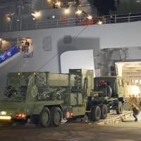 Active defense: Vehicles load a Patriot-3 antiballistic missile defense system into a Self-Defense Forces transport ship heading for Okinawa, on Monday in Kure, Hiroshima Prefecture. | KYODO