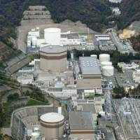 Divided opinion: The Tsuruga power plant's No. 1 (front) and No. 2 nuclear reactors are seen in an aerial photo taken on Monday. | KYODO