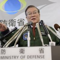 Progress report: Defense Minister Satoshi Morimoto gestures during a news conference at the ministry Wednesday afternoon, following the firing of a North Korean long-range rocket into the Pacific Ocean near the Philippines.   KYODO