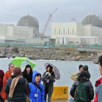 Eye-opener: Participants in a bilateral tour aimed at learning about South Korea's atomic energy operations visit the Shin Kori plant in Ulsan, which faces the Sea of Japan, on Dec. 2. | ERIKO ARITA