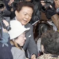 Never looked back: Naoki Inose is surrounded by voters Nov. 29 while campaigning for the Tokyo gubernatorial election in front of JR Shinjuku Station. | KYODO