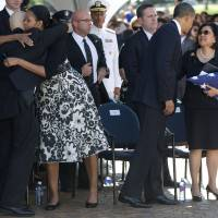 Shared loss: U.S. President Barack Obama comforts Irene Hirano Inouye, the widow of Sen. Daniel Inouye, as first lady Michelle Obama embraces Inouye's son, Daniel Ken Inouye Jr., during a memorial service for the late senator at the National Memorial Cemetery of the Pacific on Sunday. | AP