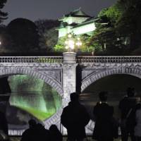 Rare sight: Nijubashi Bridge at the Imperial Palace in central Tokyo is illuminated Sunday night as part of yearend and New Year's celebrations. | KYODO
