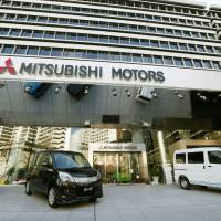 Showtime: Cars are displayed at Mitsubishi Motors Corp. head office in Tokyo's Minato Ward on Tuesday. | KYODO