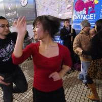 Speaking with their feet: Members of Let's Dance give a salsa demonstration in Tokyo's Shibuya district on Dec. 13 to draw support for their petition to revise a law being used to crack down on small dance clubs and live music venues. | ALBERT SIEGEL