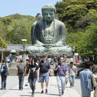 Kamakura comes up short: The Great Buddha in Kamakura, Kanagawa Prefecture, is seen in a photo taken last month. | KYODO