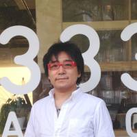 Engage: Shigeki Matsuura, editor-in-chief of Huffington Post Japan, poses outside the company's office in Tokyo on April 15. | AYAKO MIE
