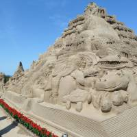 Creature feature: Animal images figure prominently in a sand sculpture made for the 26th annual sand art festival that opened Thursday on a beach in Minamisatsuma, Kagoshima Prefecture. | KYODO