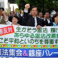 Keeping the faith: Japanese Communist Party chief Kazuo Shii (third from right) and Mizuho Fukushima (fourth from right), who heads the Social Democratic Party, march with other protesters in Tokyo's Hibiya district on Friday. | YOSHIAKI MIURA