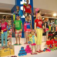 Making inroads: Casual clothing for both kids and adults is displayed at Old Navy's Sakae outlet near Nagoya Station. | CHUNICHI SHIMBUM