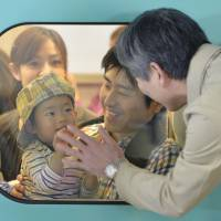 Homeward bound: A boy and his father say goodbye to a relative Sunday before their bullet train departs from JR Sendai Station. Holidaymakers crowded trains, planes and automobiles as the Golden Week holidays started coming to an end. | KYODO
