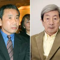 Writer Haruki Murakami (left), in a public interview conducted Monday by literary critic Yutaka Yukawa (right), says his latest book is 'an attempt at something new.' | KYODO