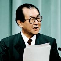 Historic words: Chief Cabinet Secretary Kozo Igarashi speaks at a news conference in Tokyo in June 1994. | KYODO