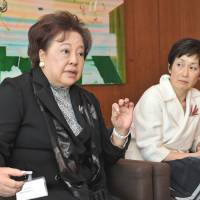 Role models: Aiko Okawara (left) and Izumi Kobayashi, cochairs of the newly established Japan chapter of Women Corporate Directors, are interviewed by The Japan Times in Tokyo on April 26. | YOSHIAKI MIURA