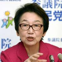 DinosAxed: Former Foreign Minister Yoriko Kawaguchi hosts a news conference Thursday in the Diet. | KYODO
