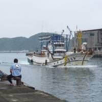 Jumping the gun: A Taiwanese fishing boat arrives back at a port in Yilan County, northeast Taiwan, on Thursday. | KYODO