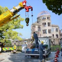 Up to code: Workers prepare to assess the earthquake resistance of the Atomic Bomb Dome in Hiroshima on Monday. | KYODO