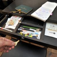 Free use: Customers who become members of bunbougu cafe are given a key that lets them access various stationery items locked away in the drawers of tables at the establishment in central Tokyo. | YOSHIAKI MIURA