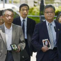 Kin of expressway tunnel collapse victims sue operator