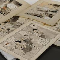 Missing pieces: Cartoonist Leiji Matsumoto's sheets of unpublished comic strips created by the late artist Osamu Tezuka are displayed. | KYODO