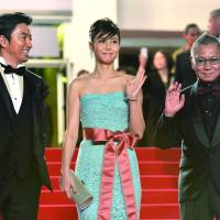 CANNES DO ATTITUDE: Actors Takao Osawa (left) and Nanako Matsushita, and director Takashi Miike, arrive Monday for the screening of the film 'Shield of Straw' ('Wara no Tate') at the 66th edition of the Cannes Film Festival in France. | AFP-JIJI