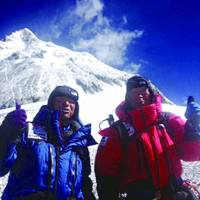 On top of the world: Alpinist Yuichiro Miura (right) and his son, Gota, pose at the South Col camp Wednesday before departing on their attempt to scale Mount Everest. Miura on Thursday became the oldest man to reach the summit. | MIURA DOLPHINS CO./AP
