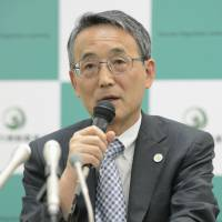 Finding fault: Nuclear Regulation Authority Chairman Shunichi Tanaka addresses reporters Wednesday after the watchdog fully backed a report that said reactor 2 at the Tsuruga nuclear plant in Fukui Prefecture is sitting on top of an active geological fault.   KYODO
