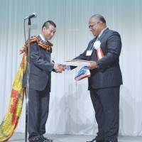 Fiji's Ambassador Isikeli Mataitoga (right) presents Honorary Consul General Takeyuki Moriya the Consular Commission during a ceremony held in Sendai on May 17. | EMBASSY OF FIJI