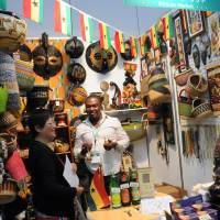 Out of Africa: Visitors view masks, food and baskets at the Ghanaian booth Thursday during African Fair 2013 in Yokohama. | SATOKO KAWASAKI