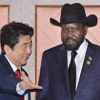 After you: Prime Minister Shinzo Abe welcomes South Sudan President Salva Kiir Mayardit ahead of their bilateral meeting Friday in Yokohama. | AFP-JIJI