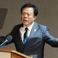 Going for the gold: Tokyo Gov. Naoki Inose delivers a presentation touting the capital as host of the 2020 Summer Olympics on Thursday in St. Petersburg, Russia. | KYODO