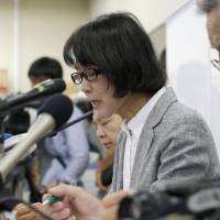 Ax to grind: Supporters of former South Korean 'comfort women' speak at a news conference Friday in Osaka after they canceled a meeting with Osaka Mayor Toru Hashimoto.  | KYODO