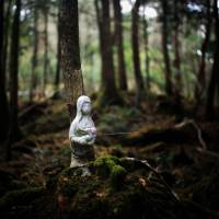 A figure bound to a tree where someone took their own life. | ROB GILHOOLY