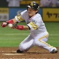 Anything for the team: The Hawks' Yuichi Honda attempts to bunt in the second inning against the Lions in Fukuoka on Thursday in their Pacific League game. Fukuoka Softbank defeated Seibu 7-5. | KYODO