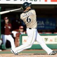 Power surge: The Fighters' Sho Nakata belts a seventh-inning home run, his third of the game, in Hokkaido Nippon Ham's 13-1 win over the Tohoku Rakuten Golden Eagles on Friday in Sendai. | KYODO