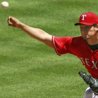 Texas Rangers starting pitcher Yu Darvish, who tied his career high with 14 strikeouts, pitches Sunday during a game against the Boston Red Sox. | KYODO