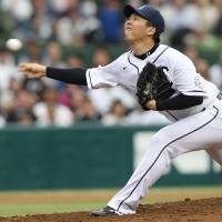 Seibu Lions pitcher Ken Togame hurls a pitch at a Monday afternoon game against the Nippon Ham Fighters. | KYODO