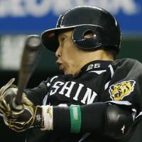 No mercy: Hanshin's Takahiro Arai hits a two-run home run in the sixth inning of the Tigers' 10-5 win over the Lions on Sunday. | KYODO