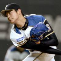 It's a start: Fighters rookie hurler Shohei Otani tosses a pitch in his start for Hokkaido Nippon Ham on Thursday against the Tokyo Yakult Swallows at Sapporo Dome. | KYODO