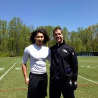 Direct hotline: Takashi Kurihara poses for a photo with Ravens head coach John Harbaugh during the team's minicamp in Owings Mills, Maryland, earlier this month.   TAKASHI KURIHARA