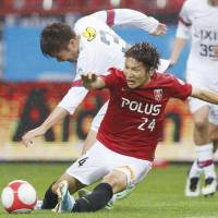All eyes on us: Urawa's Genki Haraguchi vies for the ball during a 3-1 victory over Kashima on Saturday. | KYODO