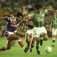 Step back in time: Verdy Kawasaki's Kazuyoshi Miura (right) takes on the Yokohama Marinos defense during the opening match of the J. League's inaugural season on May 15, 1993. | KYODO