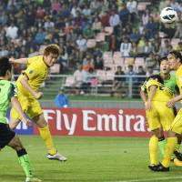 Off to a good start: Tatsuya Masushima heads in Reysol's second goal during a 2-0 win over Jeonbuk Motors in their first-leg match in the Asian Champions League round of 16. | KYODO
