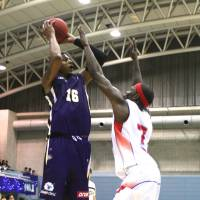 Key performer: Iwate's Reggie Okosa, seen playing defense against Tokyo earlier this season, had 16 points in the Big Bulls' 79-74 win over the Akita Northern Happinets in the teams' Eastern Conference playoff opener on Saturday. | KAZ NAGATSUKA